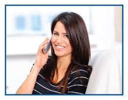 Woman smiling talking on the phone.