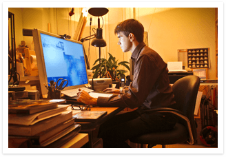 Man siting at desk working on computer.