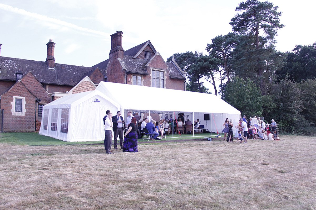 The Brethren and their guests celebrate in the July sunshine