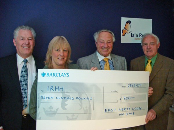 W Bros Ken Carbin and Alan Verney with Clive Verney and Liz Clarke from the Iain Rennie Hospice at Home
