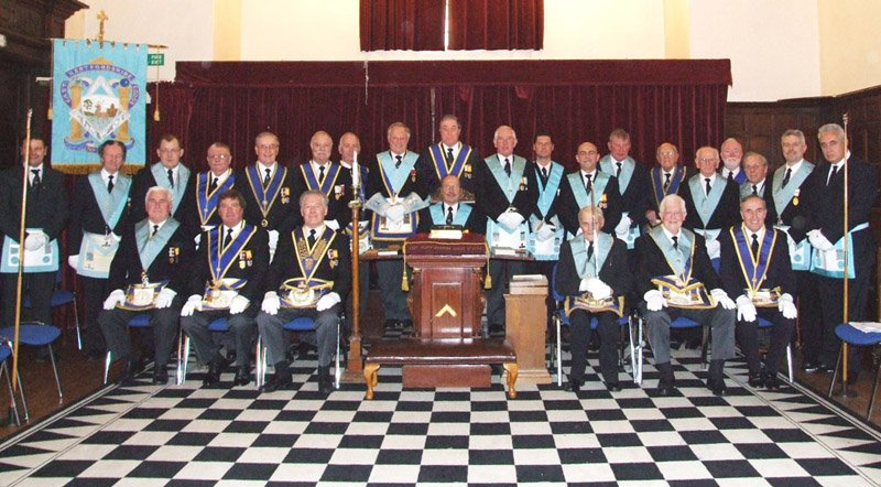 Outgoing Worshipful Master Michael Dennis, with the members of the East Hertfordshire Lodge
