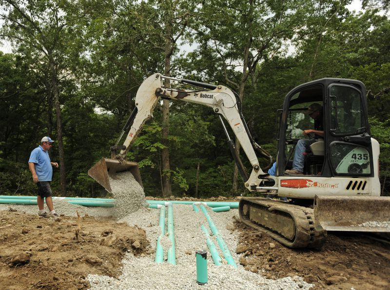 Doing general sewer plumbing with a backhoe in Jefferson City, MO