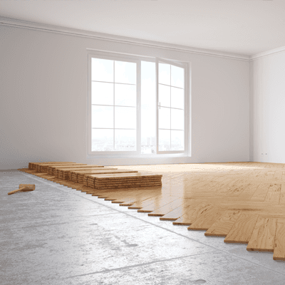 Hardwood floor being installed in a living room