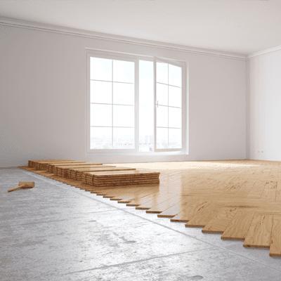 Hardwood floor being installed in a living room