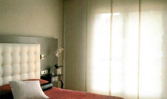 tende a pannelli per camera da letto