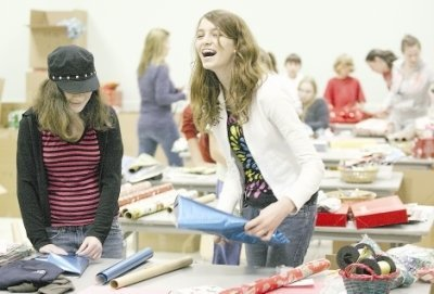 Gift Wrapping Volunteers Good News of Christmas at Quincy Mall