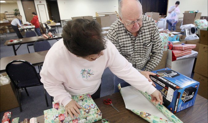 Gift Wrap Volunteers Good News of Christmas