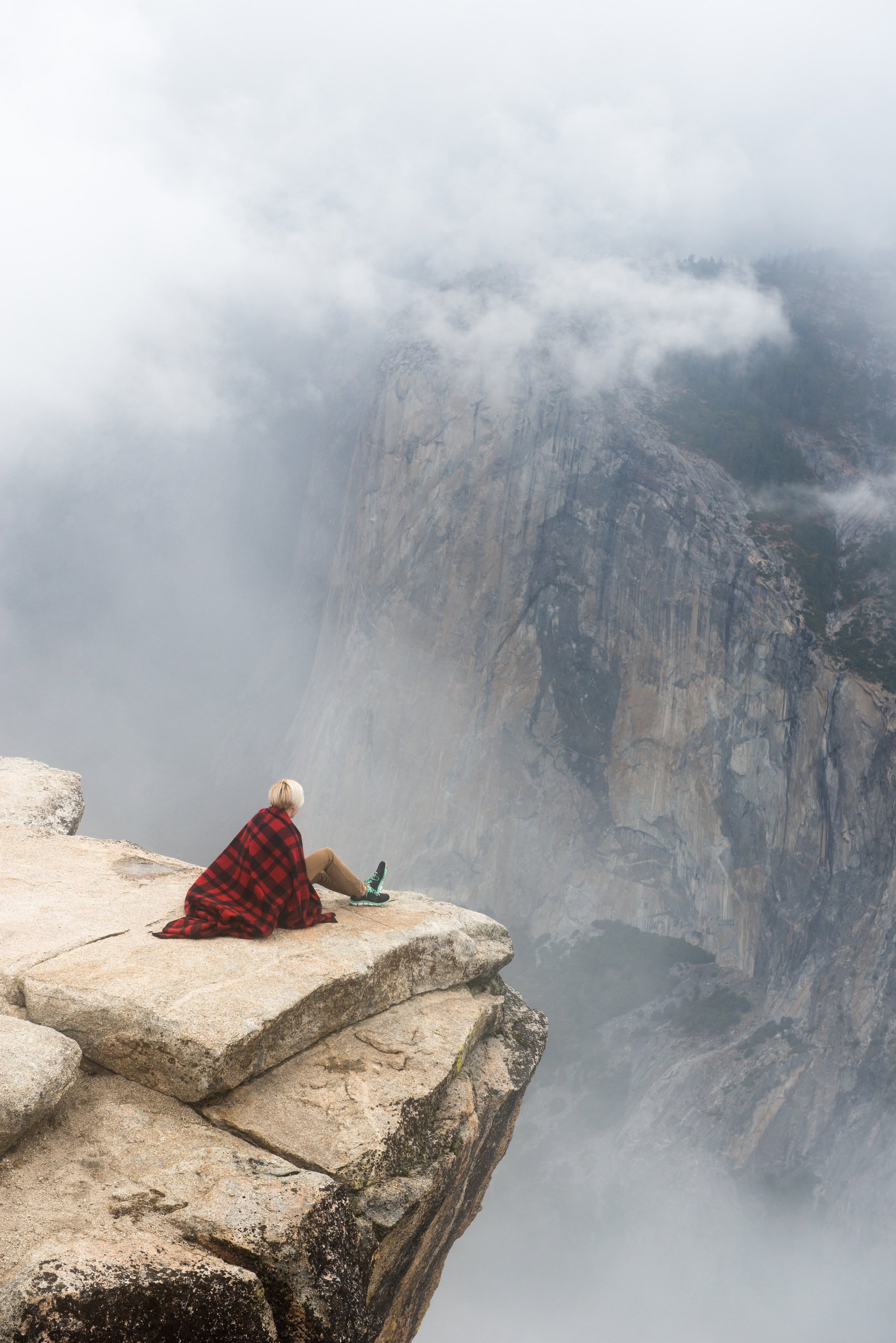 woman sitting at top of a mountain free from anxiety and phobia