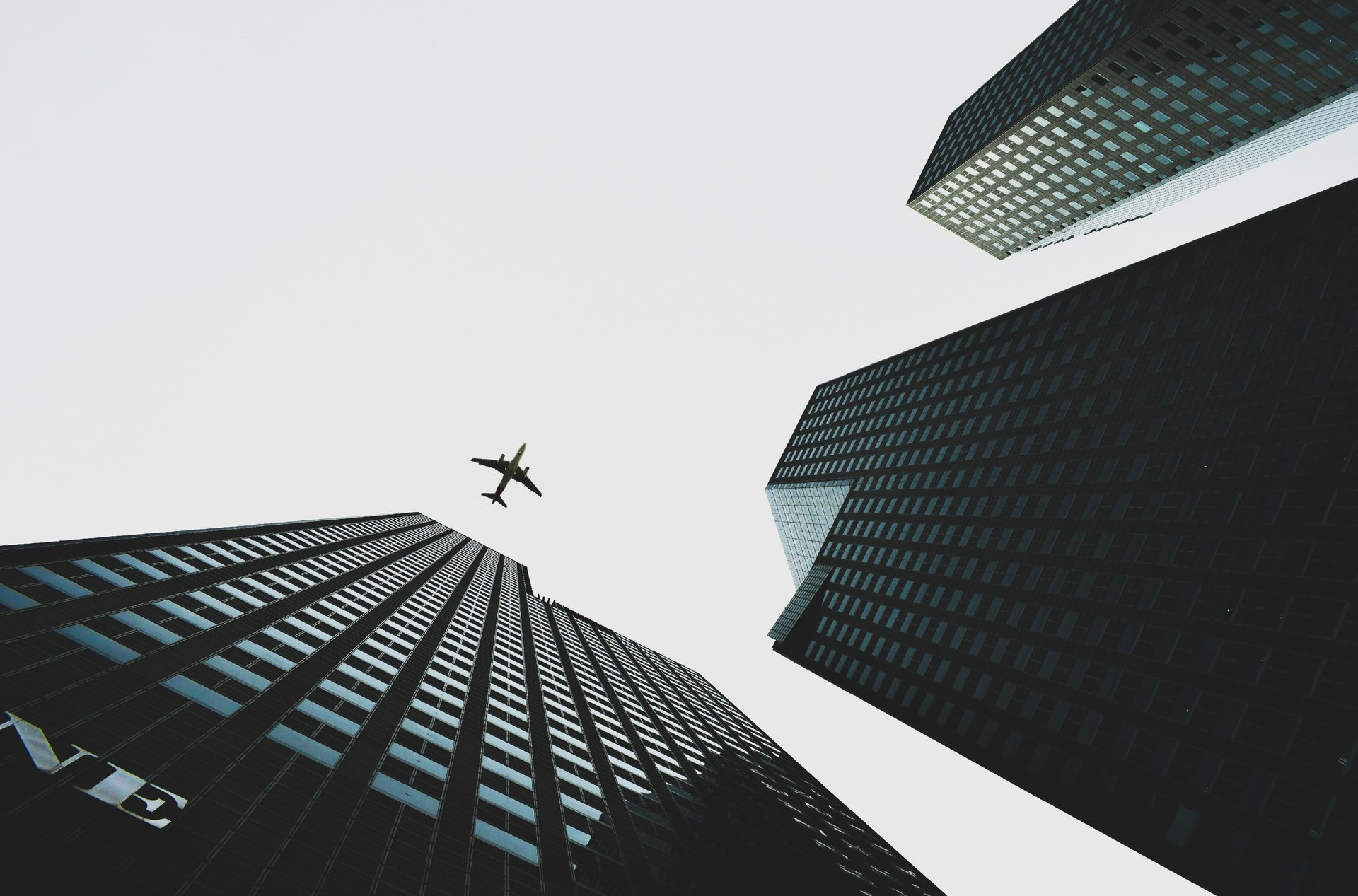 Airplane Flying Over City