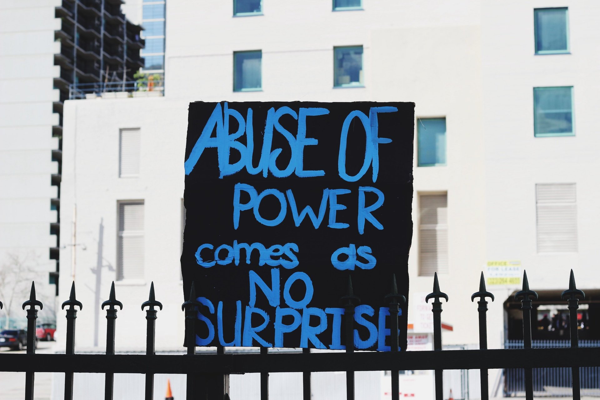 abuse of power sign